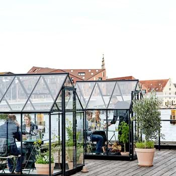 In the time of Corona, greenhouses are creating a place to meet and enjoy dinner